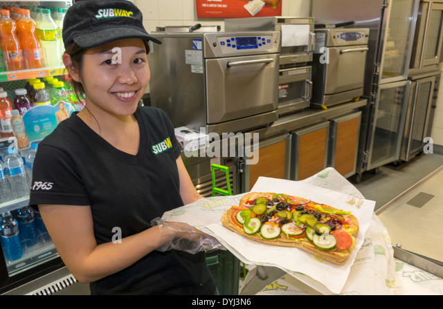Sydney Australia NSW New South Wales CBD Central Business District Subway sandwich shop restaurant Asian woman job - Stock Image