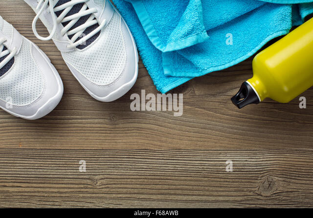 the sport concept. bottle, shoes and towel - Stock-Bilder