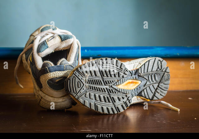 Old sports shoes at a shoe soles. - Stock-Bilder