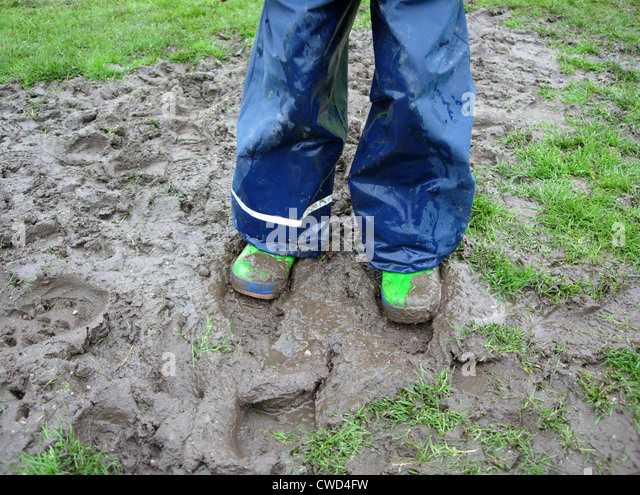 mud,galoshes,rain trousers,rainwear - Stock Image
