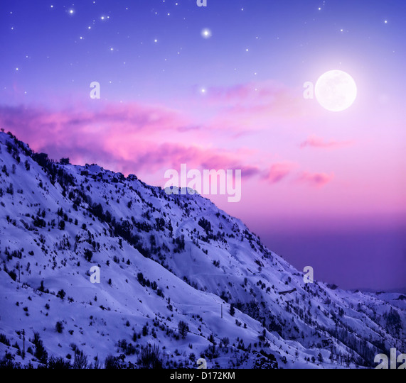 Photo of beautiful snowy mountains on purple sunset background, Faraya mountain in Lebanon covered with white snow, - Stock Image