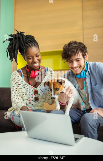 People and dog working in office - Stock Image