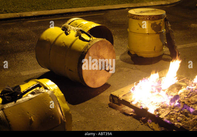 BAHAMAS Junkanoo Celebration Tightening Cowskin Drums with Fire - Stock Image