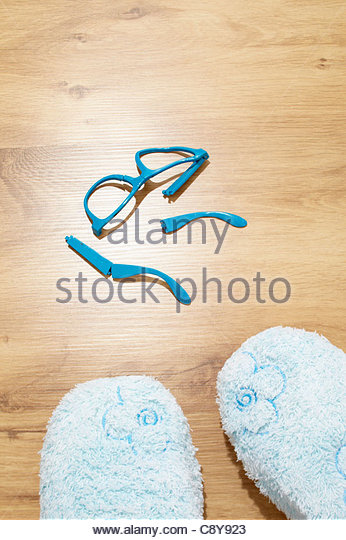 broken glasses lying on floor - Stock Image