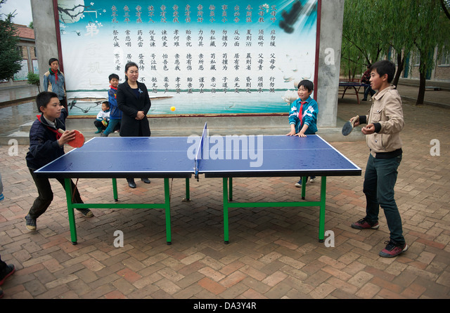 Primary school students play table tennis in Haiyuan, Ningxia Hui Autonomous Region in China. 21-May-2013 - Stock Image