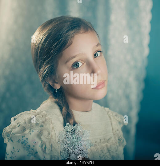 Portrait of a girl in a vintage dress - Stock Image