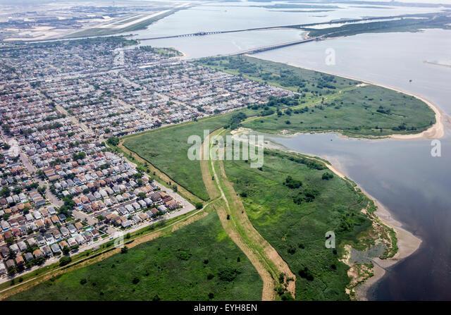 New York Queens John F. Kennedy International Airport JFK aerial approach Jamaica Bay Howard Beach Spring Creek - Stock Image