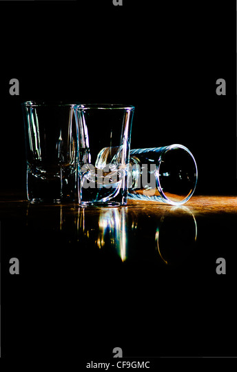 three glasses on the bar in a beam of light - Stock Image