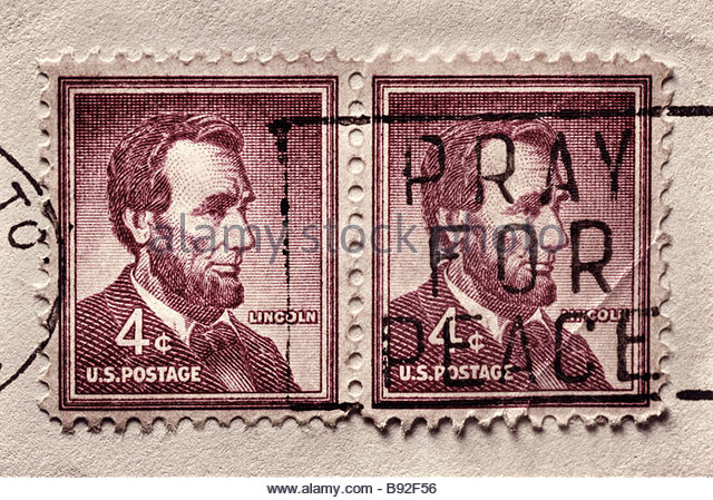 Abraham Lincoln stamps from 1960's with 'pray for peace' cancellation mark - Stock Image