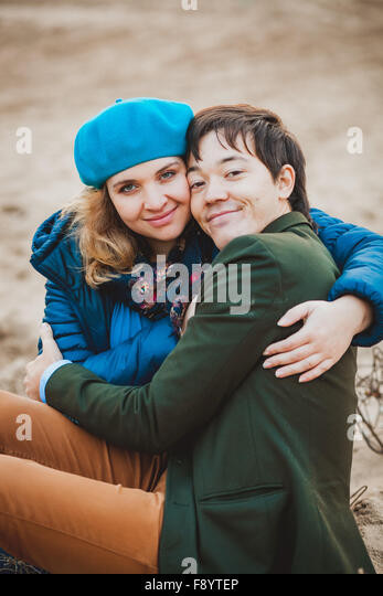 young couple walking and posing on the beach in autumn - Stock-Bilder