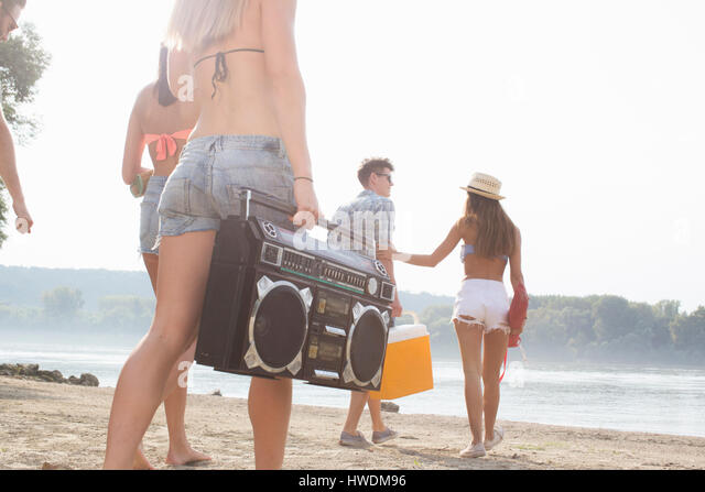 Group of friends enjoying beach party - Stock-Bilder