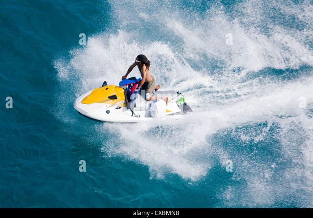 Man on a jet ski, Nassau harbor, New Providence Island, Bahamas, West Indies, Central America - Stock Image