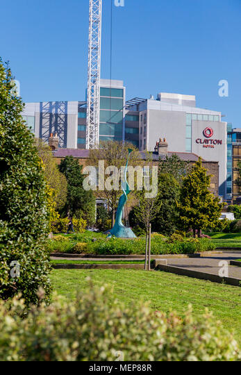 DUBLIN, IRELAND - April 21st, 2018: view of Pearse Square Park in Dublin city centre on a sunny day - Stock Image