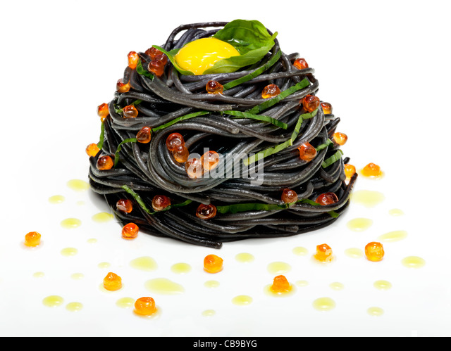 squid ink pasta with salmon roe and quail eggs - Stock Image