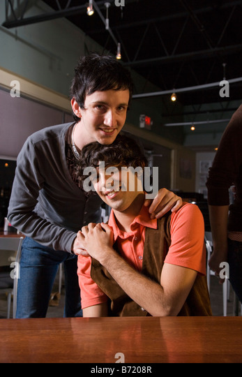 Gay couple in a restaurant - Stock Image