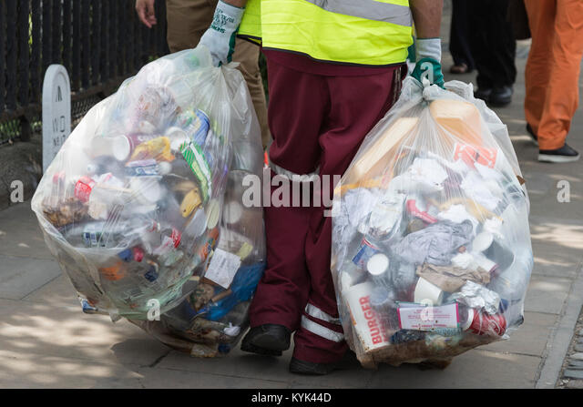 Road sweeper carrying rubbish bags, London, United Kingdom - Stock Image