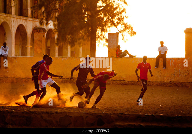 Football on the main square of Goree island, Senegal. - Stock Image
