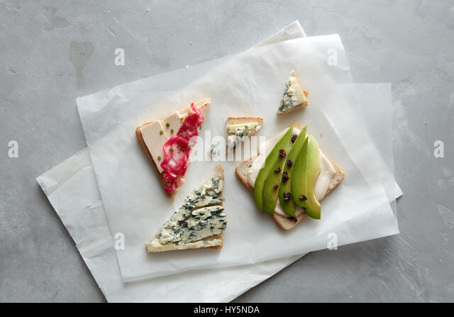 Tasty toasts with cheese - Stock Image