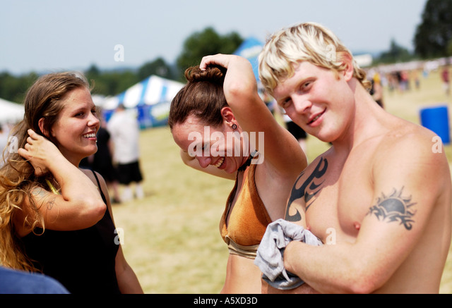 Friends at outdoor concert - Stock Image