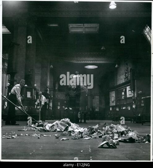 Feb. 24, 2012 - Illustrated. Stock Exchange. OPS: Day's work done, the rubbish is swept up. It is mostly paper - Stock Image