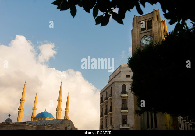 The Solidére Clock Tower in downtown Beirut in Lebanon with a mosque seen in the background. - Stock Image