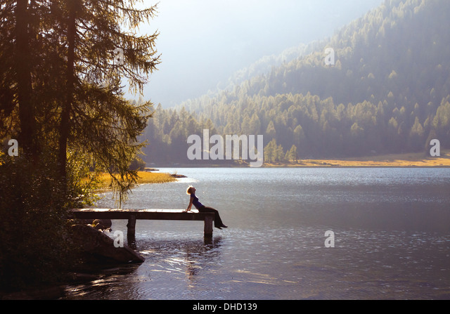 young woman enjoy the nature on the mountain lake - Stock Image