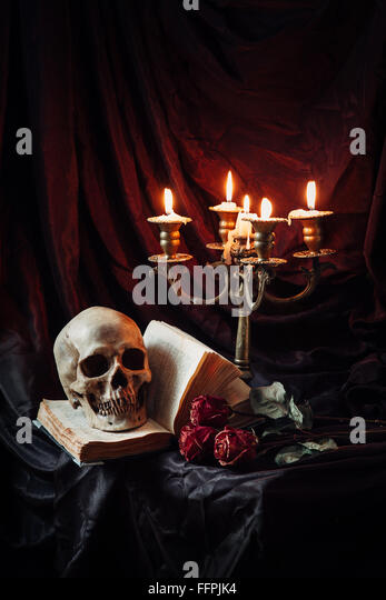 Still life with skull, book and candlestick - Stock Image
