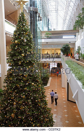 Louisiana New Orleans Canal Street Shops at Canal Place shopping center mall atrium glass elevator shopping multi - Stock Image