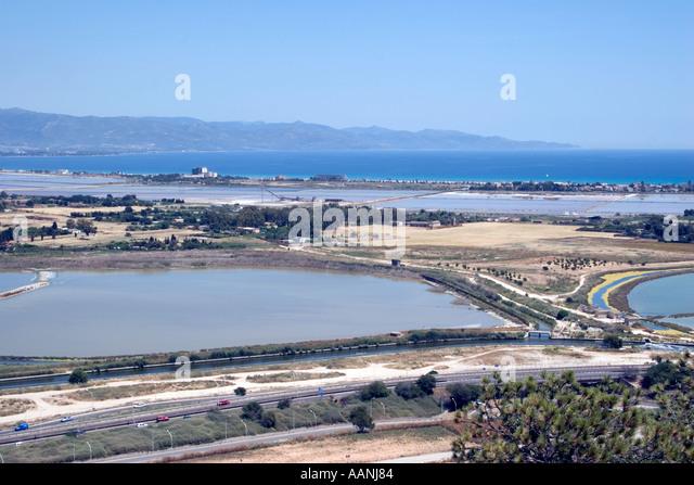 Cagliari Salt Flats Sardinia   flat salt pan shallow lagoon Devil s Saddle Sella del Diavolo landscape  rural costal - Stock Image