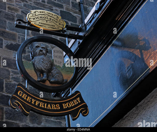 Greyfriars Bobby historic pub sign outside at dusk, Edinburgh Old Town, Dog outside, Lothians, Scotland, UK - Stock Image