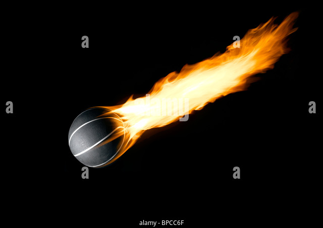 A Basketball with a burning tail like a comet - Stock Image