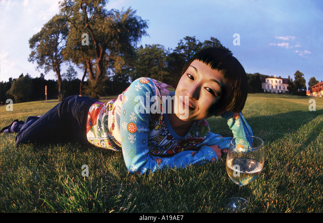 Young woman drinking wine - Stock Image