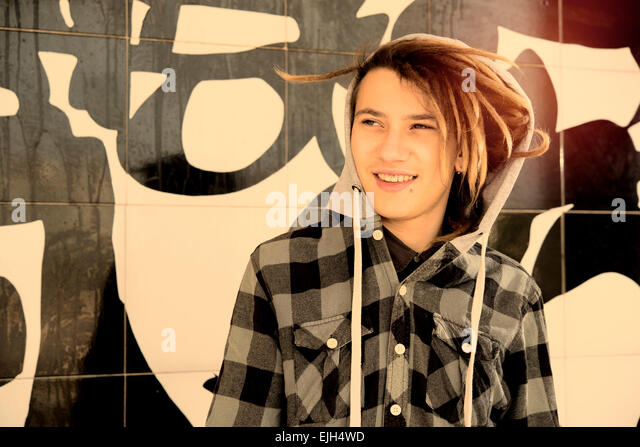 portrait of young guy  with rasta hair in a lifestyle concept warm filter applied - Stock-Bilder