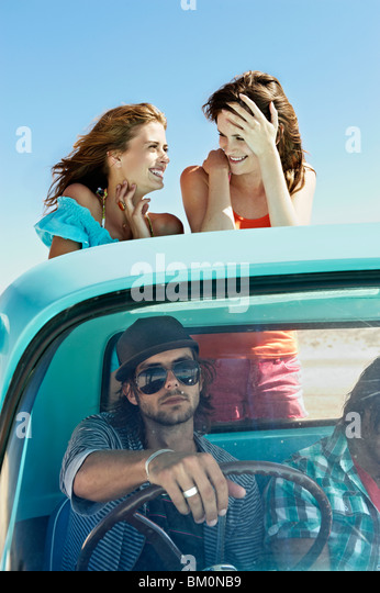 Young people traveling in pickup truck - Stock-Bilder