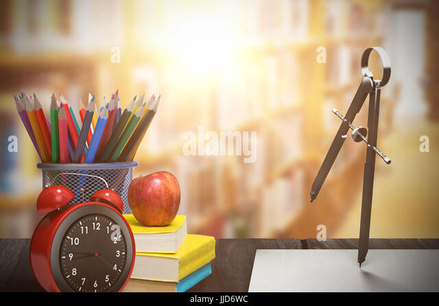 Composite of drawing compass against aisle along bookshelves in college library - Stock Image