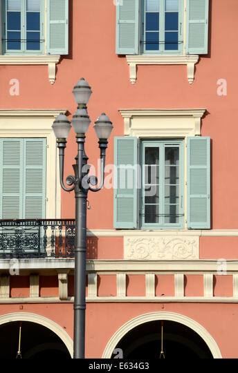 Italianate Facade of Historic Architecture and Lamppost on Place Massena Nice Alpes-Maritimes France - Stock Image