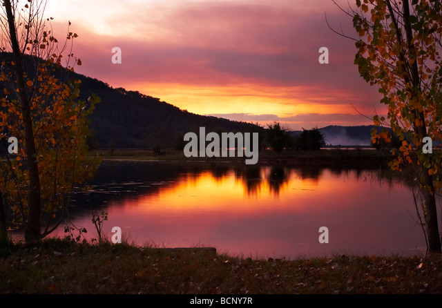 Sunset though Smoke from Burnoffs Khancoban Pondage Snowy Mountains Southern New South Wales Australia - Stock Image
