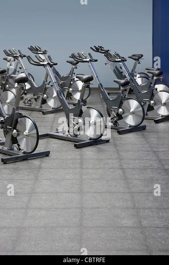 Spinning Stationary Bikes, Fitness Center - Stock Image