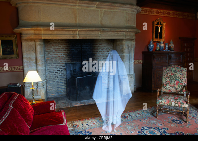 Ghost floating in ornate living room - Stock Image