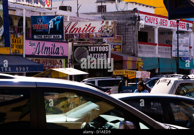 Billboards and other advertising messages in downtown Nuevo Progreso, Tamaulipas, Mexico. - Stock Image