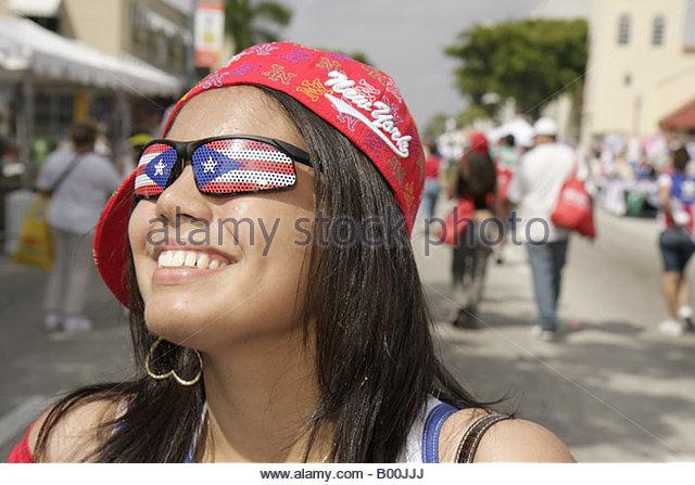 celebration street party girl teen Puerto Rico Puerto Rican flag eyeglasses pretty national pride patriotic smile - Stock Image