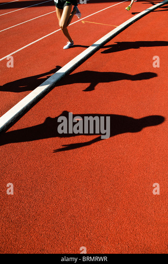 shadows of runners during 800m race during outdoor track and field competition - Stock-Bilder