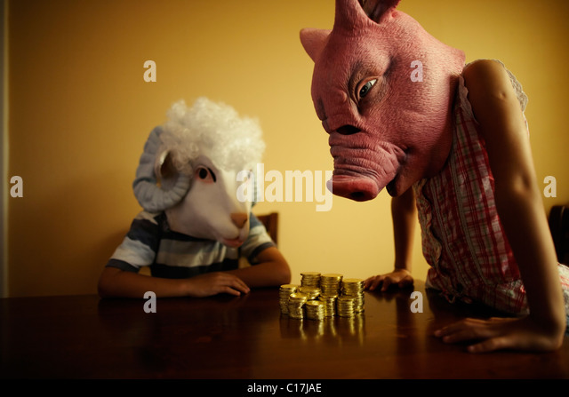 Miss Pig offers financial advice to Master Sheep. - Stock Image