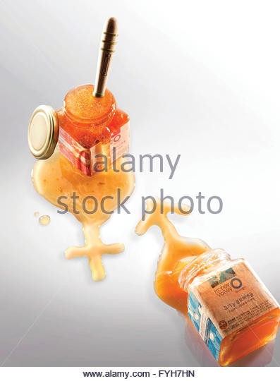 Honey brimming over - Stock Image
