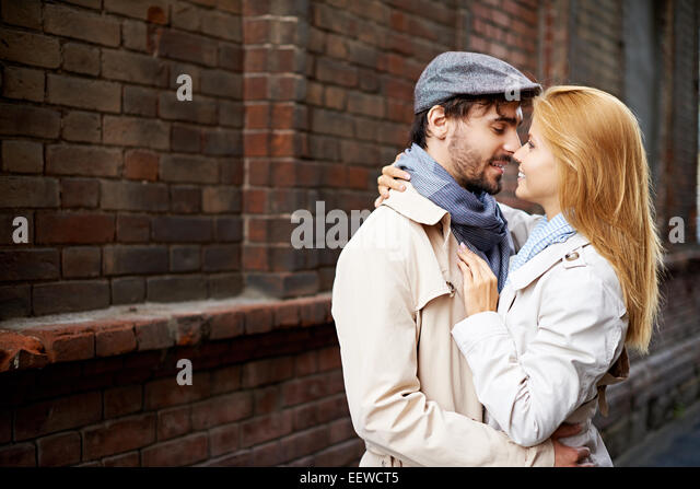 Amorous dates in stylish casualwear in urban environment - Stock-Bilder