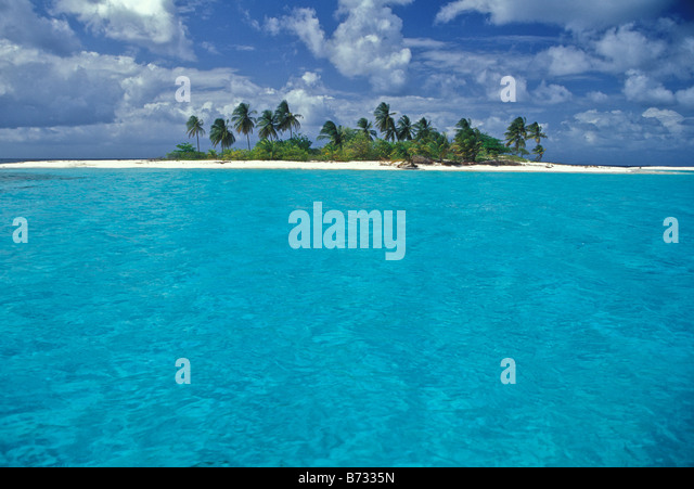 Blue green water of Caribbean with solitary island - Stock Image