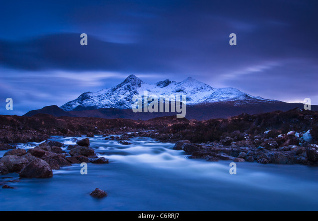 A moody twilight with aplen glow in the Cuillin Hills on the Isle of Skye, Scotland - Stock Image