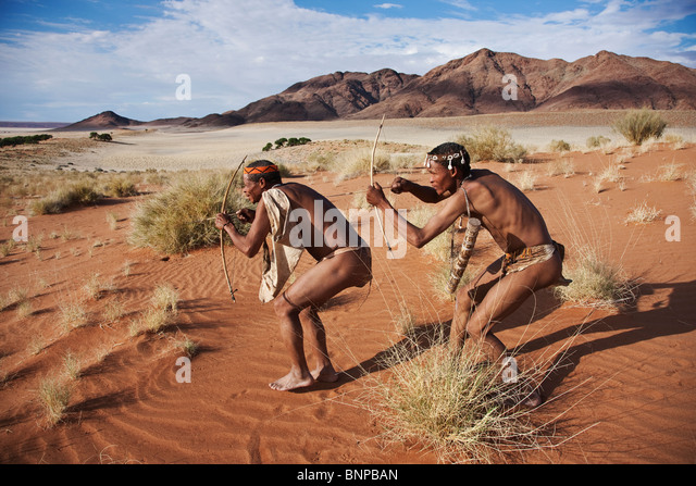 Bushman/San People. Male San hunters armed with traditional bow and arrow - Stock-Bilder