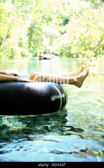 A young girl floats down the lazy river created by Rock Springs in Kelly Park, Apopka Florida. - Stock Image