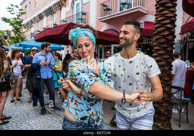 Miami Beach Florida Espanola Way grand reopening block party Hispanic celebration couple dancing salsa - Stock Image